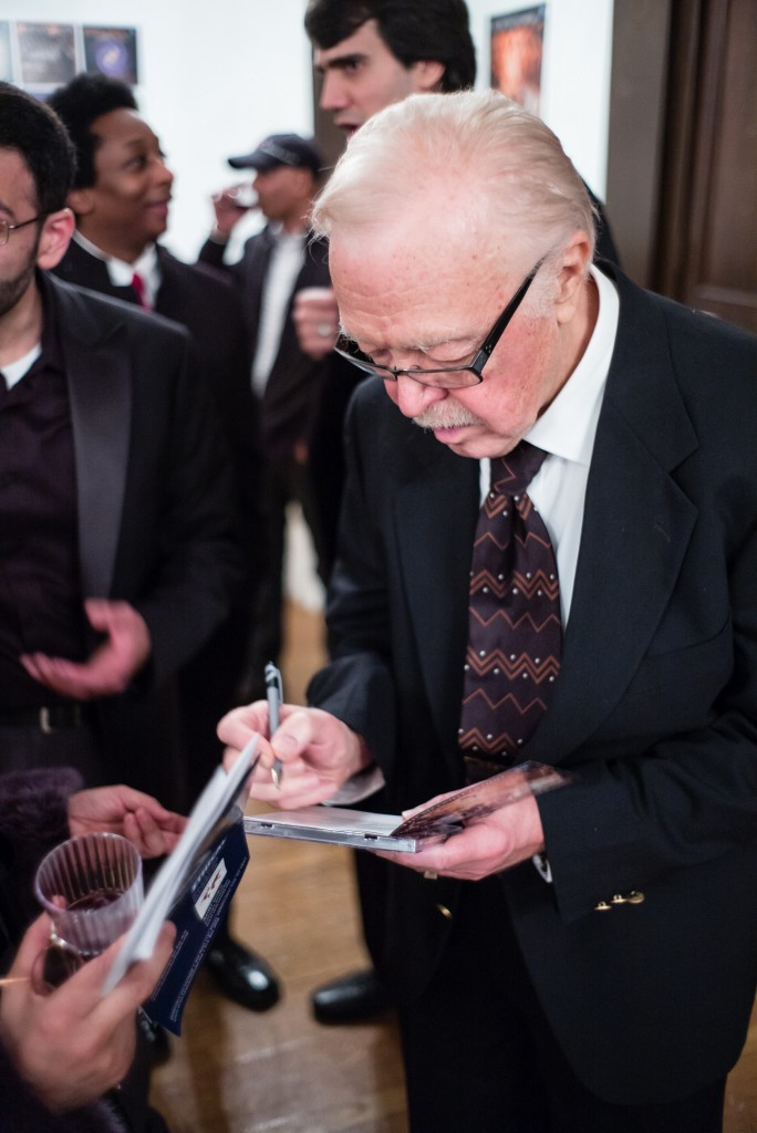 Hampson Sisler is signing CDs after the World Premiere of the Oratorio The Second Coming .